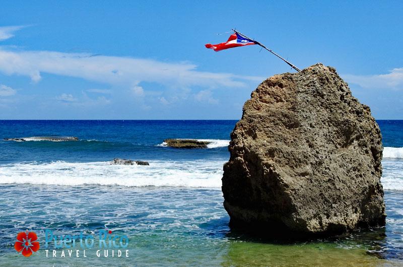 Puerto Rico Flag on Beach - Aguadilla