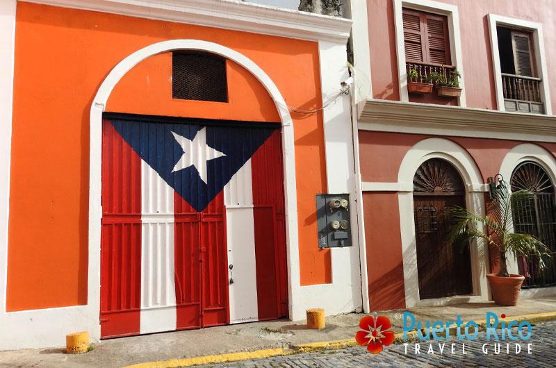 Flag on door - Old San Juan, Puerto Rico